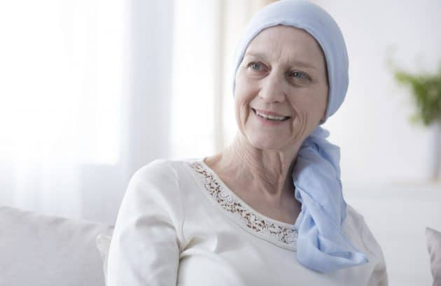 Happy woman in cancer headscarf