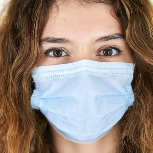 woman with white face mask
